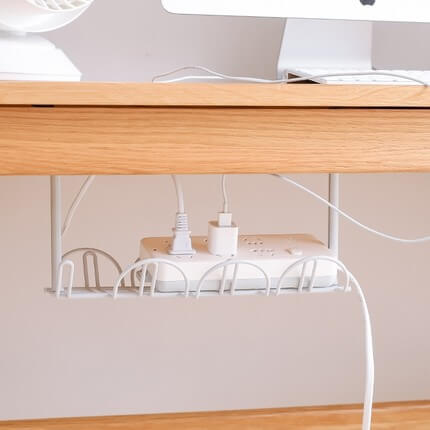 Cord organizer under the table